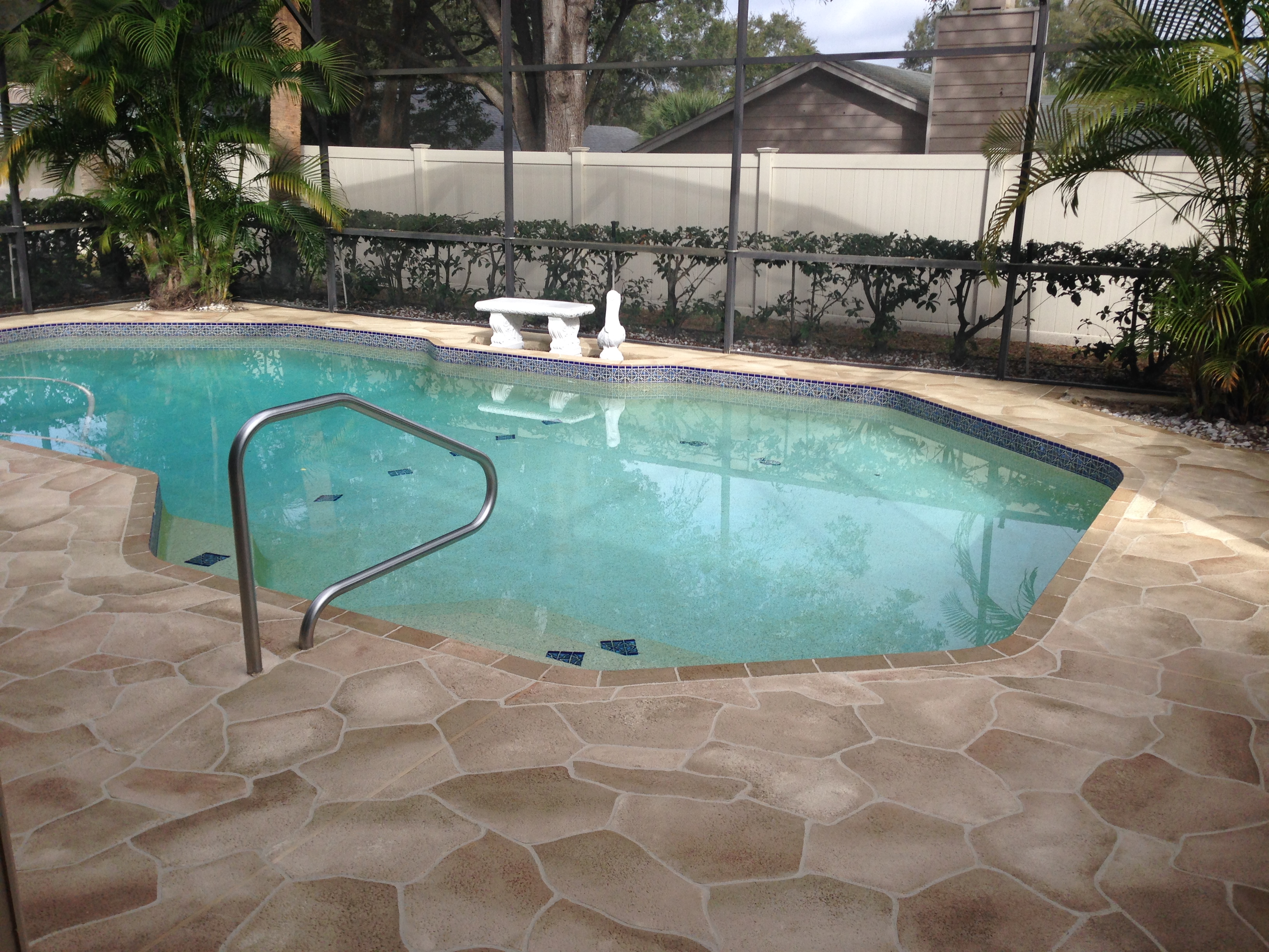 Concrete designs florida orlando flagstone pool deck for Above ground pool decks orlando