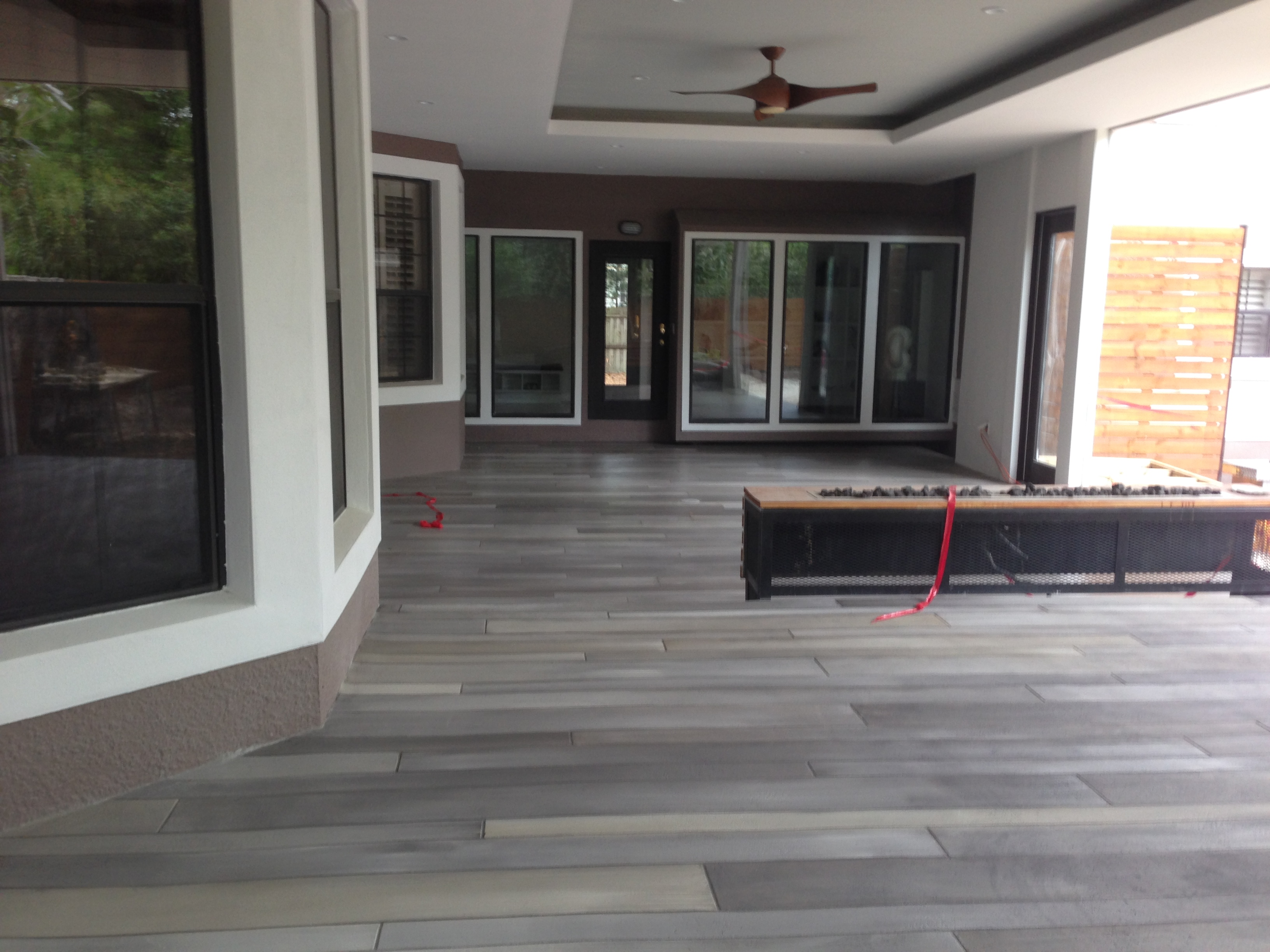 This Plain Ordinary Bare Concrete Patio Got A Sleek And Modern Makeover With Stunning Contemporary Linear Tile In Muted Charcoal Palette