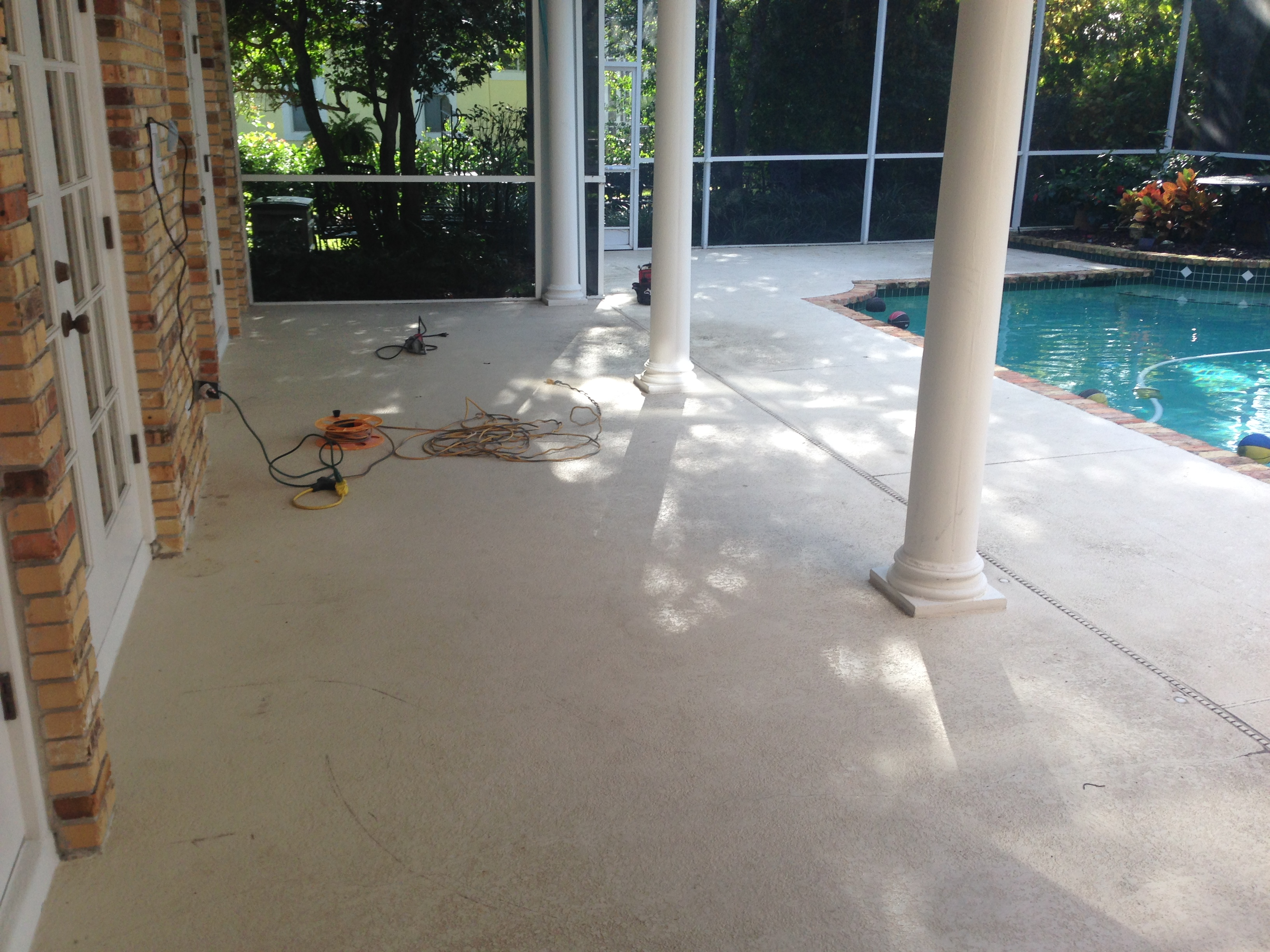 Concrete designs florida flagstone pool deck for Above ground pool decks orlando
