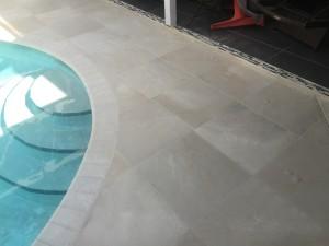 Travertine tile with light border